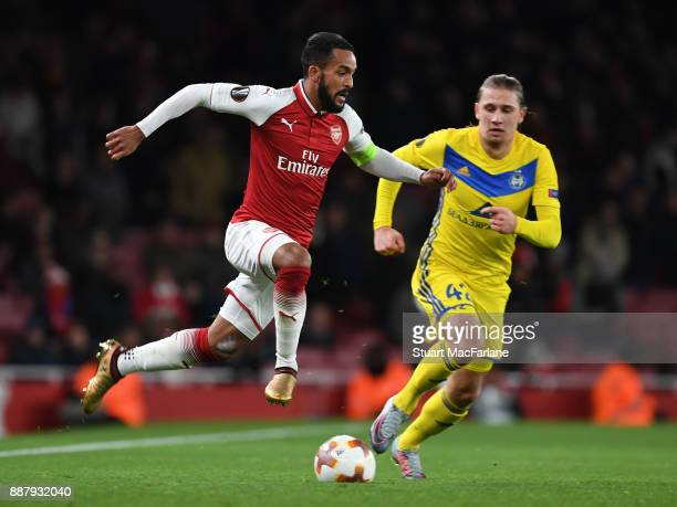 Theo Walcott of Arsenal breaks past Maksim Volodko of BATE during the UEFA Europa League group H match between Arsenal FC and BATE Borisov at...