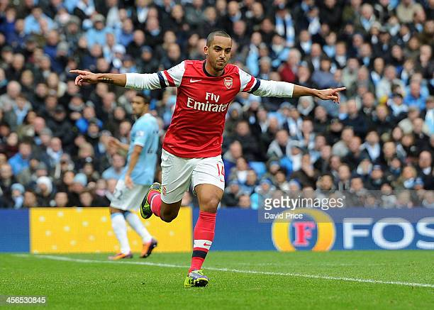 Theo Walcott of Arsenal celebrates after scoring during the Barclays Premier League match between Manchester City and Arsenal at Etihad Stadium on...