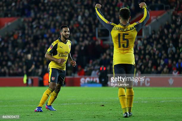 Theo Walcott of Arsenal celebrates after scoring his sides fourth goal with Alex OxladeChamberlain of Arsenal during the Emirates FA Cup Fourth Round...