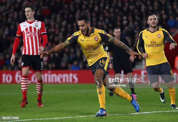 Theo Walcott of Arsenal celebrates after scoring his sides third goal during the Emirates FA Cup Fourth Round match between Southampton and Arsenal...
