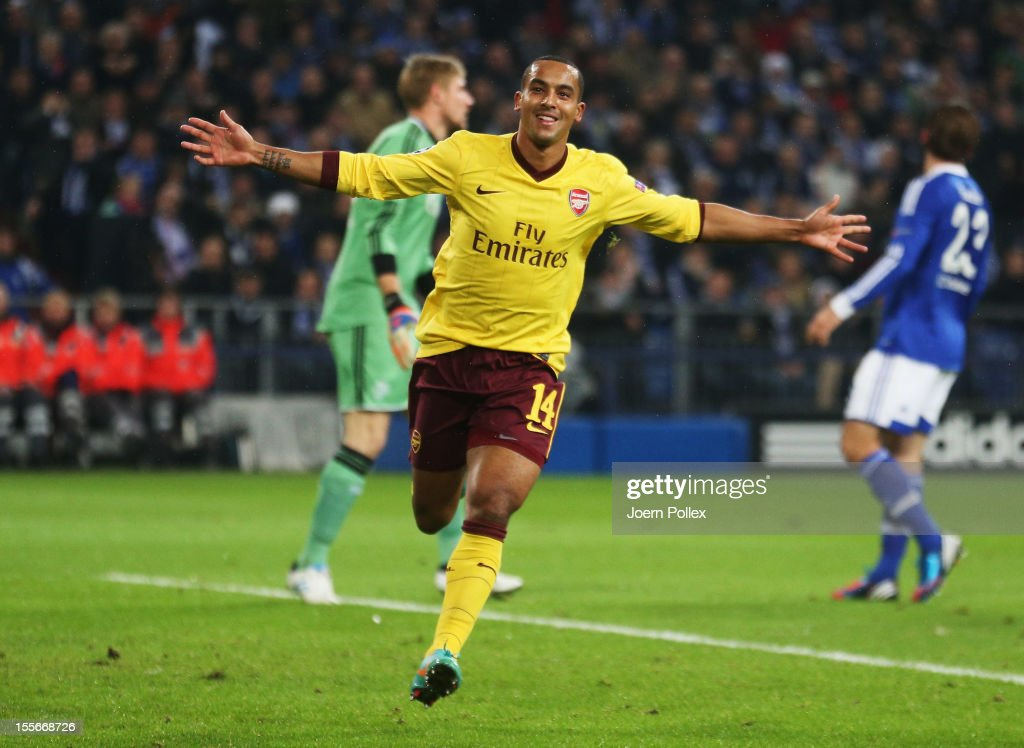 Theo Walcott of Arsenal celebrates after scoring his team's first goal during the UEFA Champions League group B match between FC Schalke 04 and Arsenal FC at Veltins-Arena on November 6, 2012 in Gelsenkirchen, Germany.