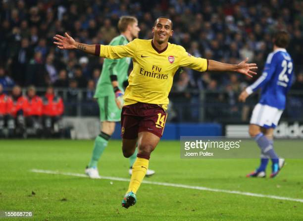 Theo Walcott of Arsenal celebrates after scoring his team's first goal during the UEFA Champions League group B match between FC Schalke 04 and...