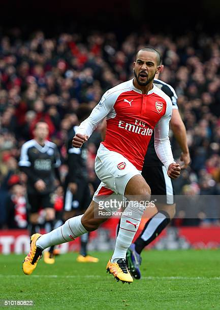 Theo Walcott of Arsenal celebrates after scoring his team's first goal during the Barclays Premier League match between Arsenal and Leicester City at...