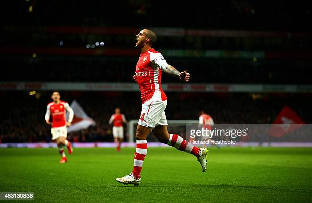 Theo Walcott of Arsenal celebrates after scoring his team's second goal during the Barclays Premier League match between Arsenal and Leicester City...