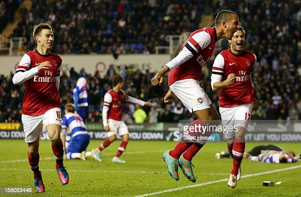 Theo Walcott of Arsenal celebrates after scoring their sixth goal during the Capital One Cup Fourth Round match between Reading and Arsenal at...