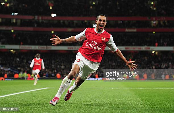 Theo Walcott of Arsenal celebrates Arsenal's third goal during the Barclays Premier League match between Arsenal and Chelsea at the Emirates Stadium...