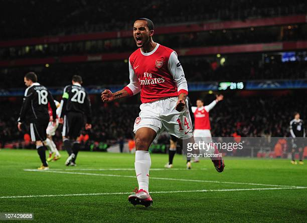 Theo Walcott of Arsenal celebrates as he scores their second goal during the UEFA Champions League Group H match between Arsenal and FK Partizan...