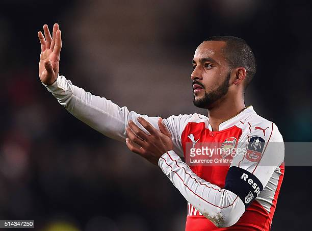 Theo Walcott of Arsenal celebrates during the Emirates FA Cup Fifth Round Replay match between Hull City and Arsenal at KC Stadium on March 8 2016 in...