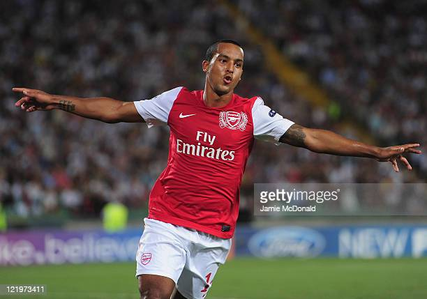 Theo Walcott of Arsenal celebrates his goal during the UEFA Champions League play-off second leg match between Udinese Calcio and Arsenal FC at the...