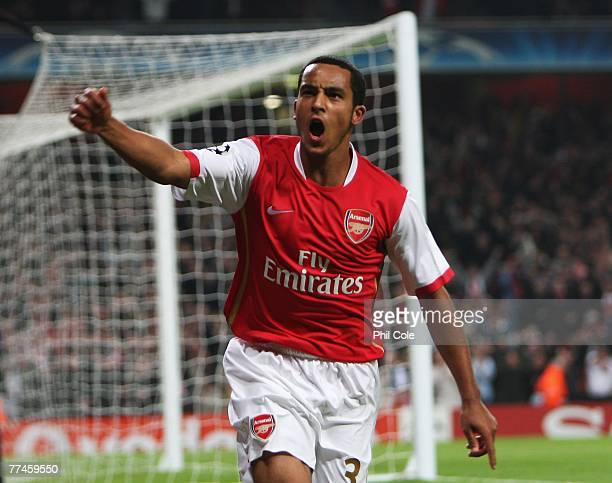 Theo Walcott of Arsenal celebrates his second goal and Arsenal's fifth during the UEFA Champions League Group H match between Arsenal and Slavia...