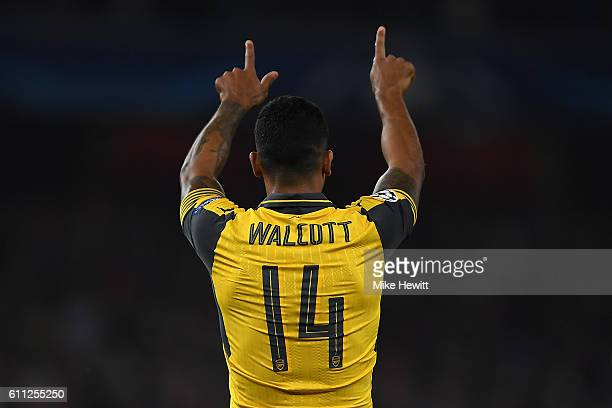 Theo Walcott of Arsenal celebrates his second goal during the UEFA Champions League Group A match between Arsenal FC and FC Basel 1893 at Emirates...