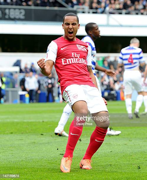 Theo Walcott of Arsenal celebrates scoring a goal during the Barclays Premier League match between Queens Park Rangers and Arsenal at Loftus Road on...