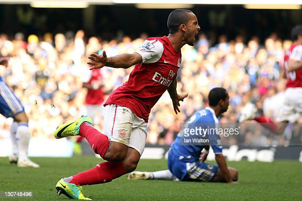 Theo Walcott of Arsenal celebrates scoring Arsenal's third goal during the Barclays Premier League match between Chelsea and Arsenal at Stamford...