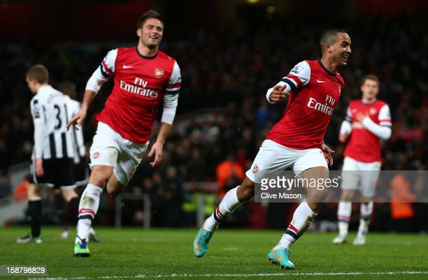 Theo Walcott of Arsenal celebrates scoring his hat trick and Arsenal's seventh goal with Olivier Giroud of Arsenal during the Barclays Premier League...