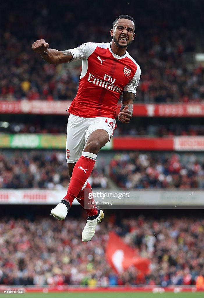 Theo Walcott of Arsenal celebrates scoring his second goal during the Premier League match between Arsenal and Swansea City at Emirates Stadium on October 15, 2016 in London, England.