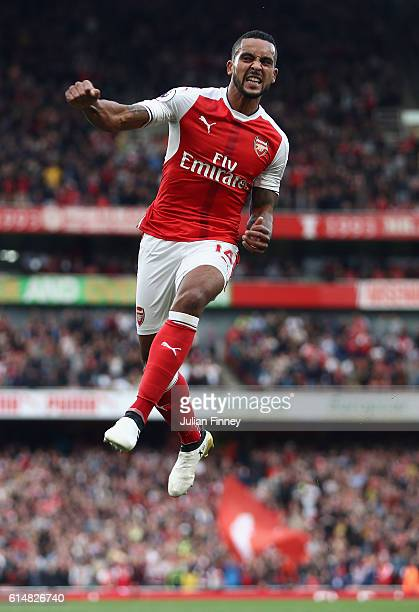 Theo Walcott of Arsenal celebrates scoring his second goal during the Premier League match between Arsenal and Swansea City at Emirates Stadium on...