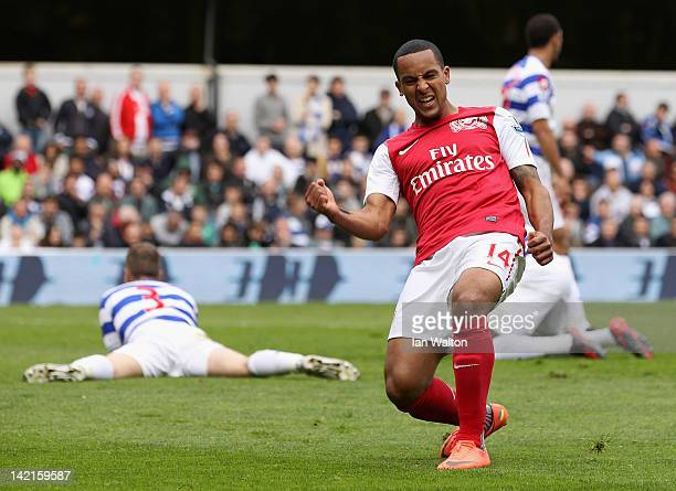 Theo Walcott of Arsenal celebrates scoring his side's equalising goal during the Barclays Premier League match between Queens Park Rangers and...