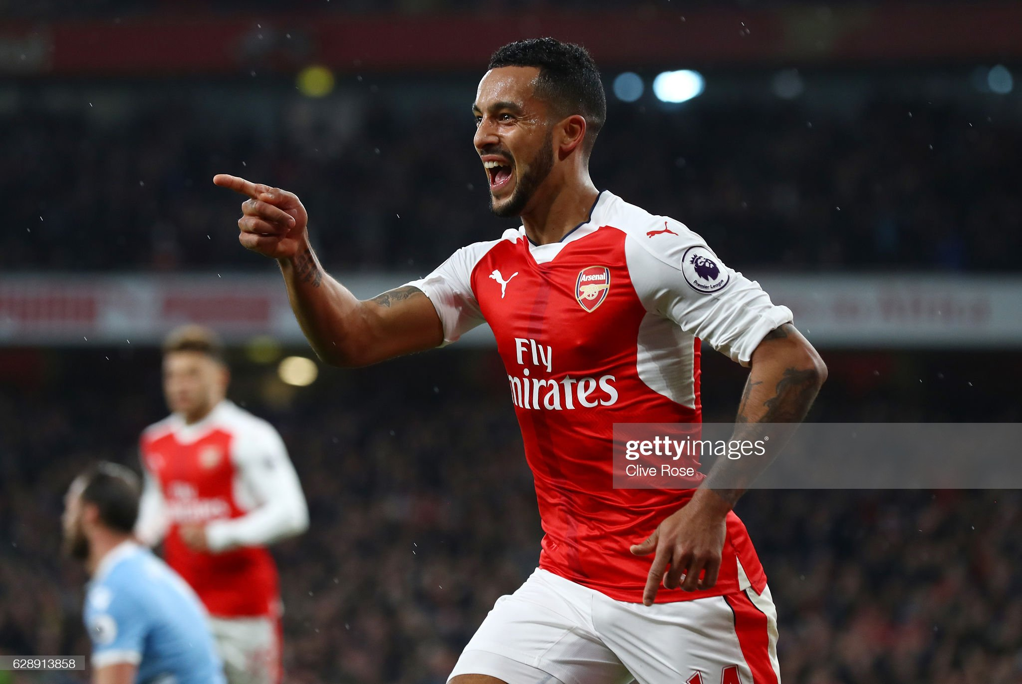 https://media.gettyimages.com/photos/theo-walcott-of-arsenal-celebrates-scoring-his-sides-first-goal-the-picture-id628913858?s=2048x2048