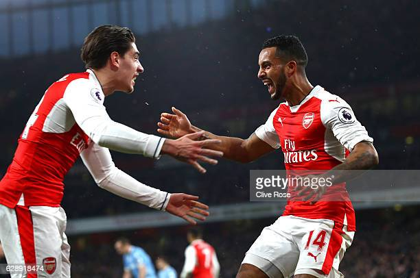 Theo Walcott of Arsenal celebrates scoring his sides first goal with Hector Bellerin of Arsenal during the Premier League match between Arsenal and...