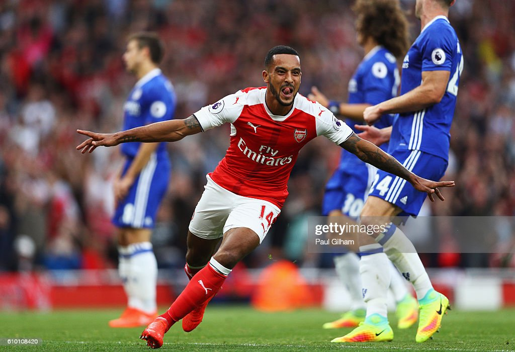 Theo Walcott of Arsenal celebrates scoring his sides second goal during the Premier League match between Arsenal and Chelsea at the Emirates Stadium on September 24, 2016 in London, England.