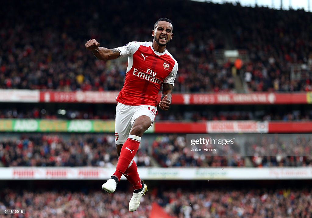 Theo Walcott of Arsenal celebrates scoring his sides second goal during the Premier League match between Arsenal and Swansea City at Emirates Stadium on October 15, 2016 in London, England.