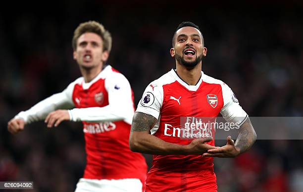 Theo Walcott of Arsenal celebrates scoring his sides second goal during the Premier League match between Arsenal and AFC Bournemouth at Emirates...
