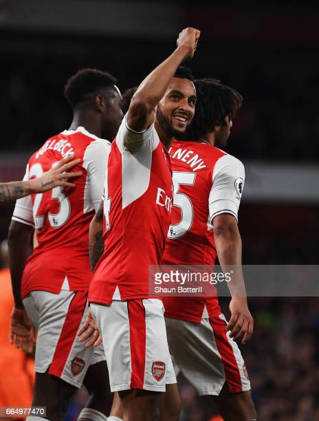 Theo Walcott of Arsenal celebrates scoring his sides second goal during the Premier League match between Arsenal and West Ham United at the Emirates...