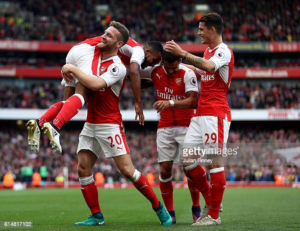 Theo Walcott of Arsenal celebrates scoring his sides second goal with his team mates during the Premier League match between Arsenal and Swansea City...