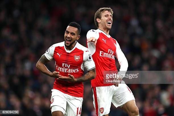 Theo Walcott of Arsenal celebrates scoring his sides second goal with Nacho Monreal of Arsenal during the Premier League match between Arsenal and...