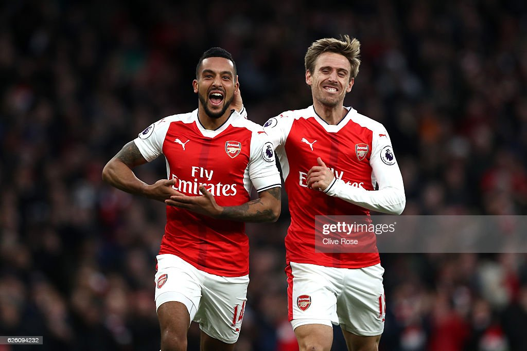 Theo Walcott of Arsenal (L) celebrates scoring his sides second goal with Nacho Monreal of Arsenal (R) during the Premier League match between Arsenal and AFC Bournemouth at Emirates Stadium on November 27, 2016 in London, England.