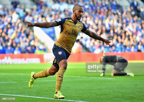 Theo Walcott of Arsenal celebrates scoring his team's first goal during the Barclays Premier League match between Leicester City and Arsenal at The...