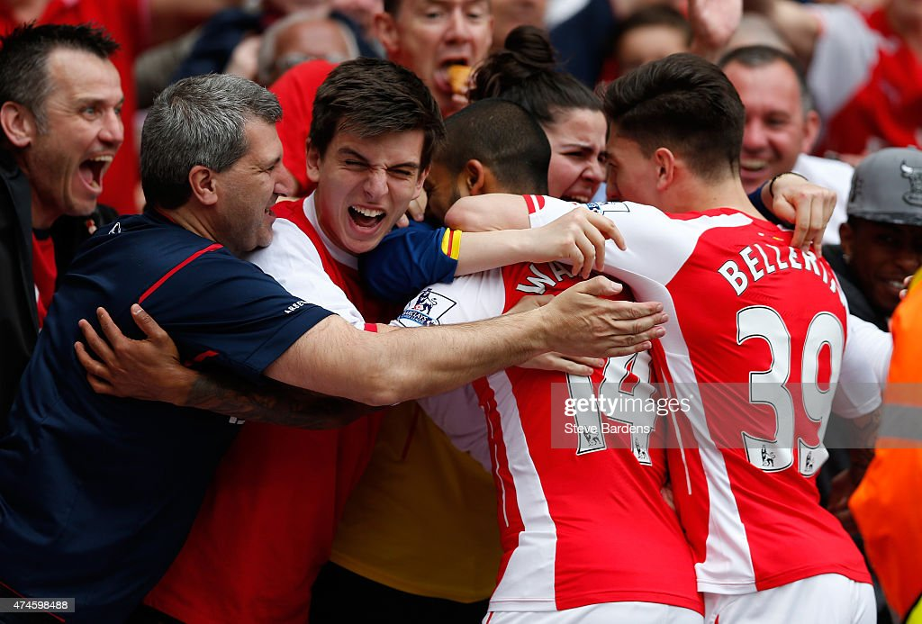 Theo Walcott (C) of Arsenal celebrates scoring his team's first goal with his team mates during the Barclays Premier League match between Arsenal and West Bromwich Albion at Emirates Stadium on May 24, 2015 in London, England.