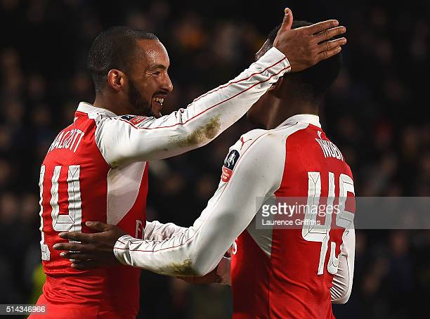 Theo Walcott of Arsenal celebrates scoring his team's fourth goal with Alex Iwobi during the Emirates FA Cup Fifth Round Replay match between Hull...