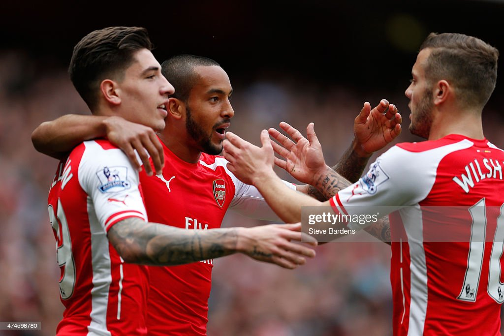 Theo Walcott (C) of Arsenal celebrates scoring his team's second goal with his team mate Hector Bellerin (L) and Jack Wilshere (R) during the Barclays Premier League match between Arsenal and West Bromwich Albion at Emirates Stadium on May 24, 2015 in London, England.