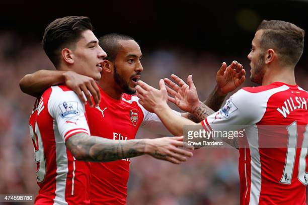 Theo Walcott of Arsenal celebrates scoring his team's second goal with his team mate Hector Bellerin and Jack Wilshere during the Barclays Premier...