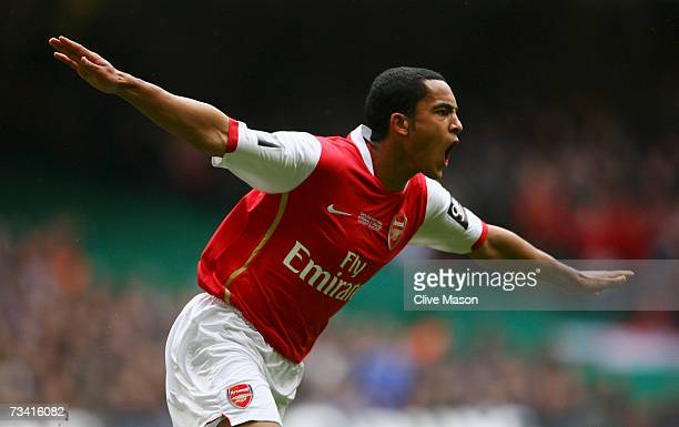 Theo Walcott of Arsenal celebrates scoring the opening goal during the Carling Cup Final match between Chelsea and Arsenal at the Millennium Stadium...