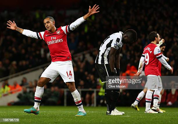 Theo Walcott of Arsenal celebrates scoring their fourth goal during the Barclays Premier League match between Arsenal and Newcastle United at the...
