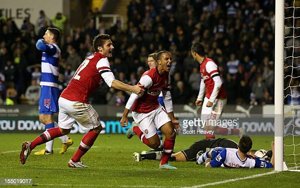 Theo Walcott of Arsenal celebrates their sixth goal during the Capital One Cup Fourth Round match between Reading and Arsenal at Madejski Stadium on...