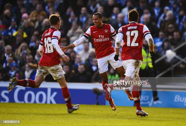 Theo Walcott of Arsenal celebrates with Aaron Ramsey and Olivier Giroud as her scores their third goal during the FA Cup with Budweiser Fourth Round...