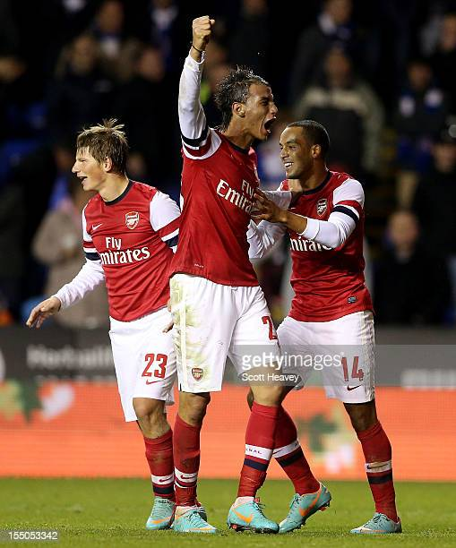 Theo Walcott of Arsenal celebrates with Marouane Chamakh and Andrey Arshavin after scoring their fourth goal during the Capital One Cup Fourth Round...