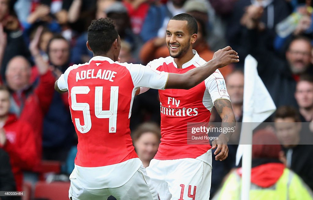 Theo Walcott of Arsenal celebrates with team mate Jeff Reine-Adelaide during the Emirates Cup match between Arsenal and VfL Wolfsburg at the Emirates Stadium on July 26, 2015 in London, England.