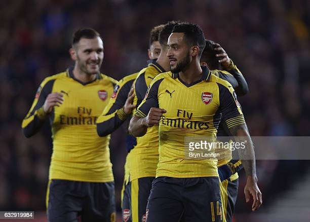 Theo Walcott of Arsenal celebrates with team mates after scoring his sides fourth goal during the Emirates FA Cup Fourth Round match between...