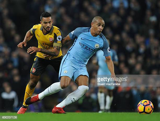 Theo Walcott of Arsenal challenges Fernando of Man City during the Premier League match between Manchester City and Arsenal at Etihad Stadium on...