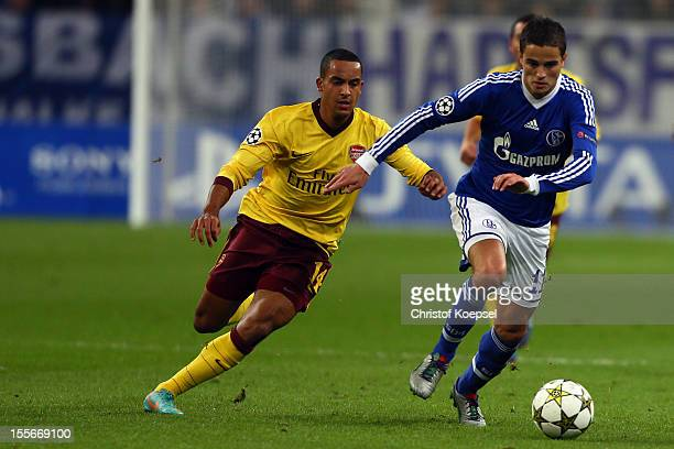 Theo Walcott of Arsenal challenges Ibrahim Affelay of Schalke during the UEFA Champions League group B match between FC Schalke 04 and Arsenal FC at...