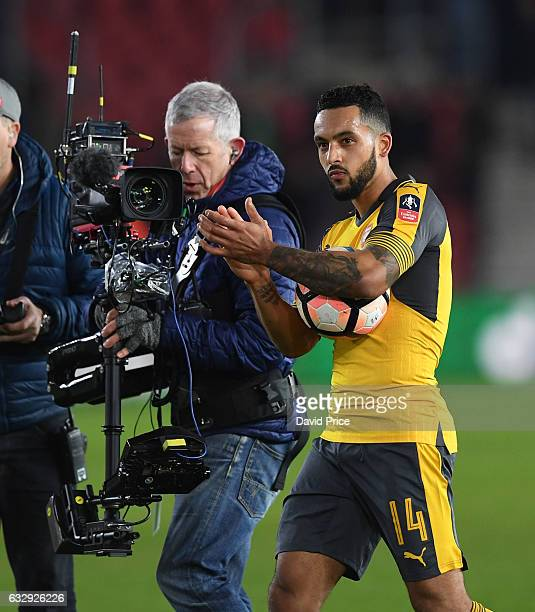 Theo Walcott of Arsenal claps the Arsenal fans after the match with the matchball under his arm after the match between Southampton and Arsenal at St...