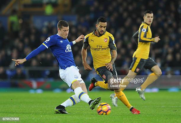 Theo Walcott of Arsenal closes down Ross Barkley of Everton during the Premier League match between Everton and Arsenal at Goodison Park on December...