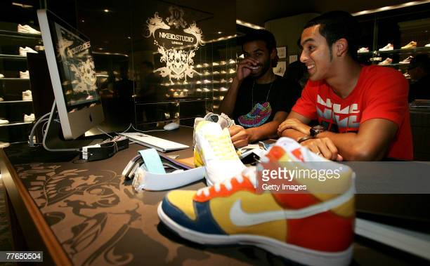 Theo Walcott of Arsenal designs his trainers during the Launch of the New NikeiD Studio in Nike Town onNovember 1 2007in London England