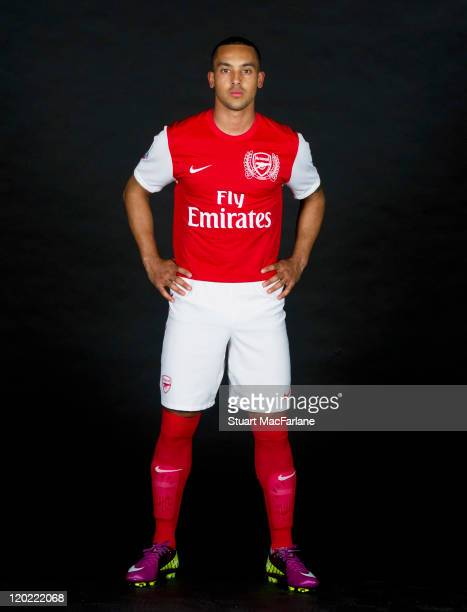 Theo Walcott of Arsenal FC poses in the Arsenal home kit for the 2011/2012 season at their London Colney training ground on April 8, 2011 in St....