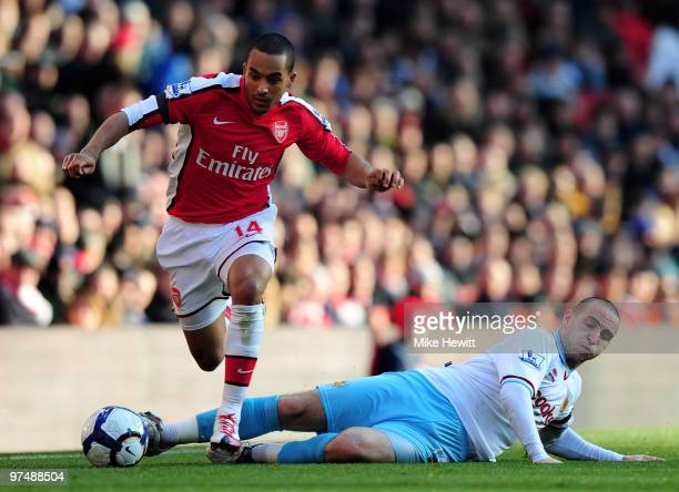 Theo Walcott of Arsenal gets away from Martin Paterson of Burnley of Burnley during the Barclays Premier League match between Arsenal and Burnley at...