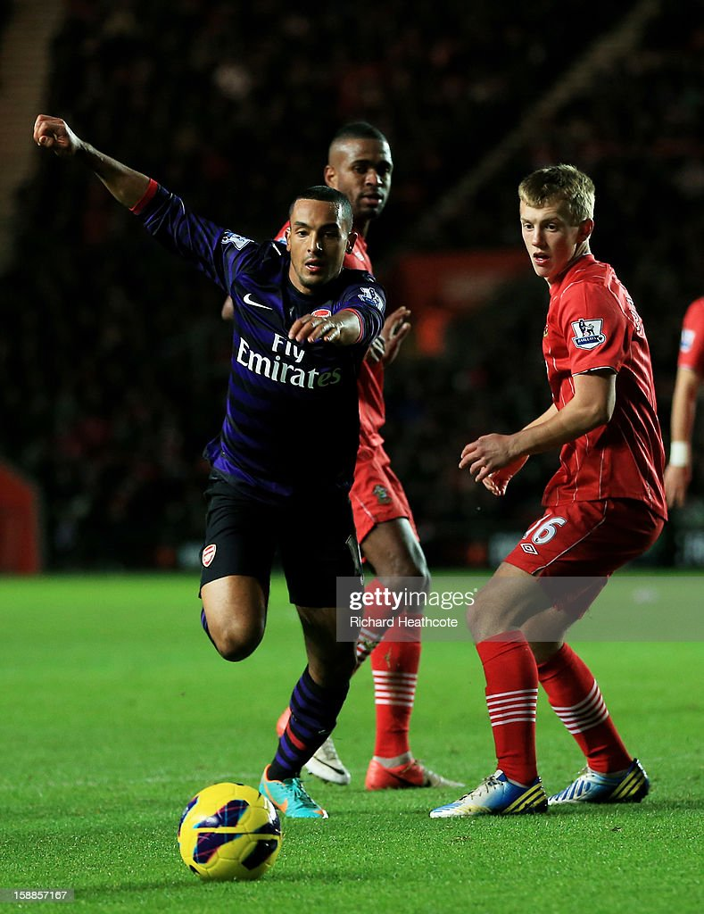 Theo Walcott of Arsenal goes past James Ward-Prowse of Southampton during the Barclays Premier league match between Southampton and Arsenal at St Mary's Stadium on January 1, 2013 in Southampton, England.